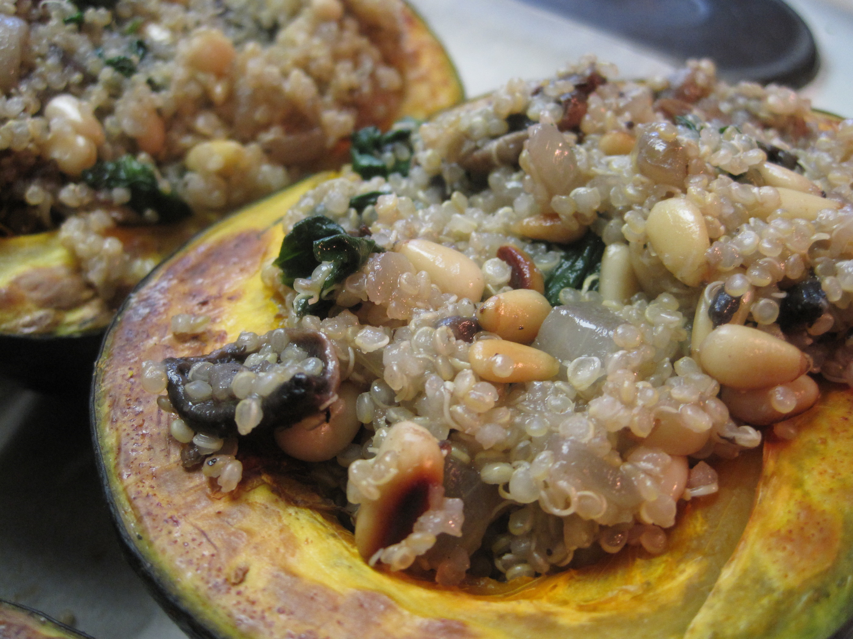Spinach, Mushroom, Quinoa and Pine Nut Stuffed Squash